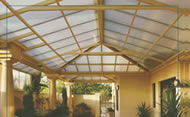 Pergola covered with  macrolon roofing.